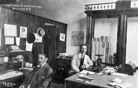"""Kootenay Cigar Factory, Nelson, BC"", Mr. Simms and Sam Bridges in the office."