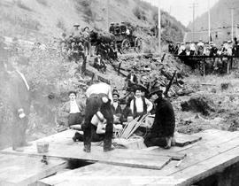 """McDonald and McGillvery at work in the rock drilling contest at Sandon, BC.""."