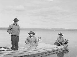 The Eddings, and Harry McLean, standing; on Ootsa Lake.
