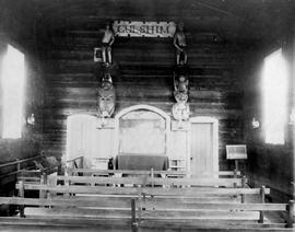 Reverend Duncan's church at Metlakahtla; interior, chapel showing totem poles.