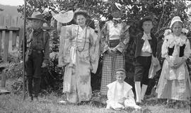 Children dressed for a masquerade party.