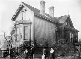 Mr. and Mrs. James Goodfellow Mann and family outside their residence.