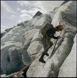 Mountain Climbers In Glacier National Park
