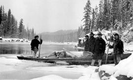 Surveyors on Lower Canyon of Upper Nechako River; surveyors are, Jack Braithwaite, George Coply, and Olaf Larson.