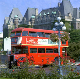 Victoria. Double Decker Bus And Empress Hotel