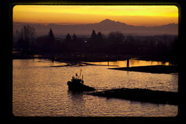 Sunrise with tugboat on the north arm of the Fraser River.