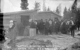 """Getting supplies at relief stores after fire, Fernie, Aug. 1, 1908."""
