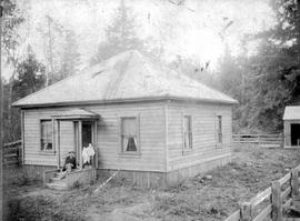 Mr. and Mrs. Robert Allen in front of their home in Chemainus.