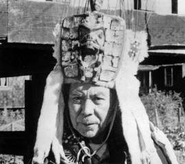 A beaver head dress ornamented with whiskers and minks.
