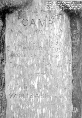 """Inscription carved on tree during time of survey of Capilano tract""."