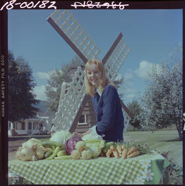 Oasis Farm, Grand Forks. Girl With Produce