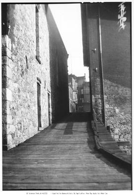 An alley at the side of the Hudson's Bay warehouse, Wharf Street, at the foot of Bastion Squ...