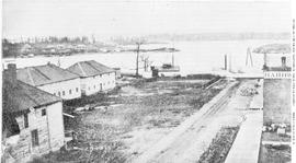 Fort Victoria; the bottom of Fort Street, at Wharf; from the saloon of the Occidental Hotel; J. Bell's Hardware at right.