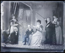 Tableau vivant featuring multiple (three) Hannah Maynards and grandson Maynard Macdonald in a stu...