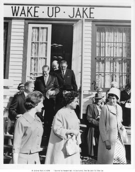 Premier W.A.C. Bennett and others outside the Wake-Up Jake Saloon; at the official opening of Barkerville as an historic site.