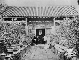 [Canton, China] The house we tiffined in, in the Gardens, the figures are indistinct because they...