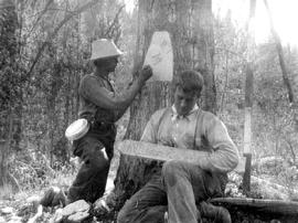Surveyors setting out boundary markers during survey of First Nations reserve no. 12.