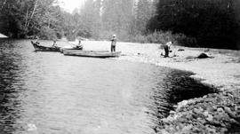 """Canoe transport on the Sarita River, near Alberni, Vancouver Island""."