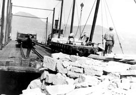 Stone (granite) being loaded aboard C.P.R. barge (C.P.R. tug Naramata), Capt. Weeks at left, Hast...