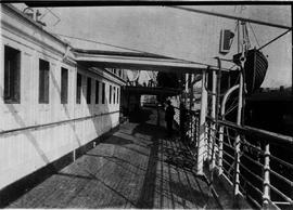 Full view promenade deck, Empress of India, looking aft; ship at dock.