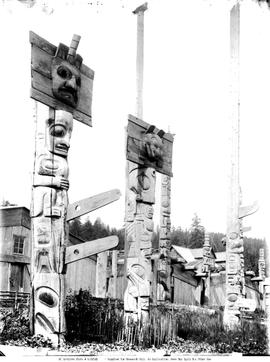 Totem poles and dwellings near Skidegate.