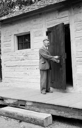 David Power at the door of Old Fort Kamloops; Mr. Power was the donor of the building.