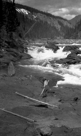 Portaging/skidding canoe in the Cascade Canyon on the Finlay River.