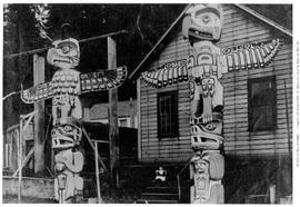 Totem poles in front of Cluet's house, Alert Bay