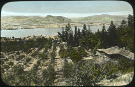 """An orchard home at Naramata""; home in right foreground on bluff overlooking Okanagan Lake"