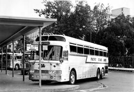 Buses at Vancouver Island Coach Lines depot, Douglas and Belleville Streets; Royal BC Museum in t...