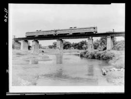 Rdc's Nos.9052 And 9051. Broadside. Far Mid-Distance. General Detail Good. Crossing A Bridge...
