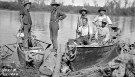 """Tatche River, Aug. 1909""; Frank Swannell, on the far left, George V. Copley standing o..."