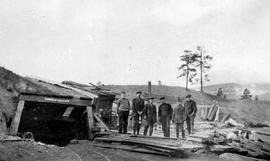 Group of men outside the entrance to a mine; miscellaneous D album.