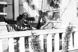 Nan Cheney (left) and artist Emily Carr on porch of 316 Beckley St., Victoria