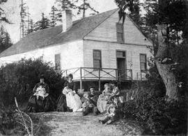Mr. and Mrs. Arthur Fellows and family at Mr. and Mrs. Kennedy's Thetis Cottage, in Esquimalt; Mrs. Fellows at centre; two nurses at left; boy with dog Walter Wilson, later a plumber