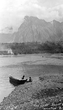 An early boat used as a ferry on the Bulkley River, near Hazelton.