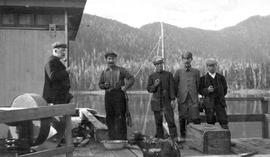 A group of men on a wharf.